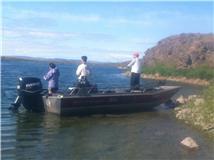 Sina, Kathy, and Michael fishing for bass